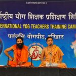 Swami Ramdevji and Acharya Balkrishanji addressing the International Meet