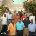 NRI delegates at the front gate of the Patanjali Yogpeeth