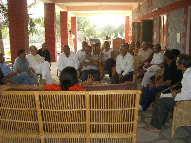 Swami Ramdevji addressing an NRI group during the Meet