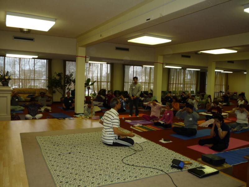 Participants performing pranayam